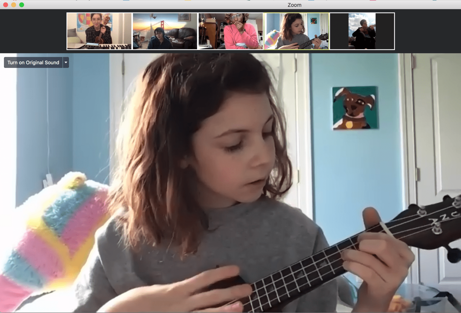 Lexy plays the ukulele for virtual lessons